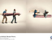 VW ad shows two men carrying out rolled up carpet with leg sticking out at end, next image shows a bird eye view of the man at end is holding carpet in one arm and mannequin legs in the other arm