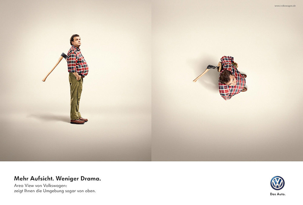 VW ad showing the man stabbed in the back with axe, next image shows same man from bird's eye view showing that the axe wasn't in his back but in a log that he's holding with his arm