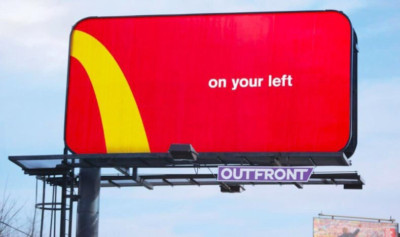 a billboard displays a small piece of McDonald's golden arches